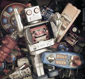 Old toys. Big silver robot in a pile of old toys Stock Images