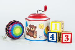 Old toys. Yo-yo, tin hurdy-gurdy musical box and cubes with numbers Royalty Free Stock Images