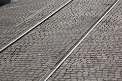 Old tracks across cobbles pavements. Picture taken in Gothemburg, Sweden Royalty Free Stock Photography