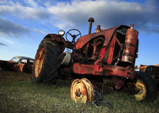 Old Tractor. An old red tractor in a field of junk stock images