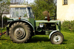 Old tractor. Old green tractor is steel working on the fields Royalty Free Stock Images