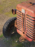 Old tractor. Old vintage tractor left outside to rust Royalty Free Stock Image