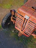 Old tractor. Old vintage tractor left outside to rust Stock Image