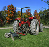 Old Tractor. Rear view of an old red tractor at a farm Royalty Free Stock Photography