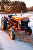 Old Tractor. In the field in winter time royalty free stock image