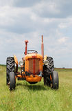 Old tractor. In field in spring Stock Photo