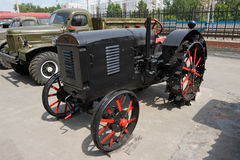 Old tractor. Old fashioned tractor with iron wheel Stock Photo