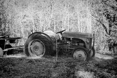 An old tractor abandoned in a field Royalty Free Stock Image
