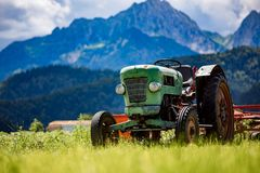 Old tractor in the Alpine meadows Royalty Free Stock Images