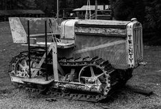 Old tractor. Old antique tractor in black and white in field royalty free stock photography