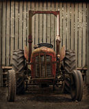 Old Tractor by Barn Royalty Free Stock Photo