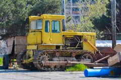 Old tractor bulldozer at plant Stock Image