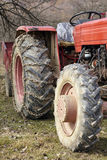 Old tractor closeup on wheels Stock Photography