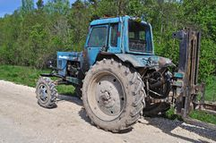 Old tractor on country road Royalty Free Stock Photography