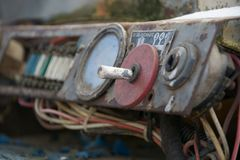 Old tractor dashboard. Vintage damaged dashboard in old tractor vehicle Stock Images