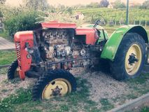 Old tractor. Decoration on the ranch Royalty Free Stock Images
