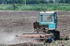 Old tractor DT75 harrows the soil in the floor. Tractor DT-75, Rostov-on-Don, Russia, August 23, 2015 stock photo