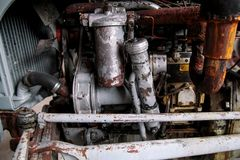 Old tractor engine. With many modifications. Rusty, but working. Old agricultural machine Stock Image