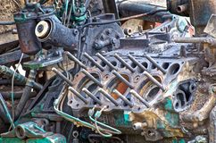 Old tractor engine with removed cylinder head. Old outworn disassembled russian tractor engine with detached cylinder head and visible pistons royalty free stock photo