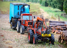 Old tractor and equipment used in timber industry. Stock Images