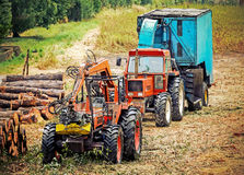 Old tractor and equipment used in timber industry. Royalty Free Stock Photos
