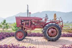 Old tractor in the farm Stock Photos