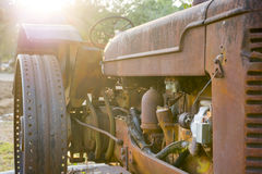 Old tractor. Old farming tractor and old engine Stock Image