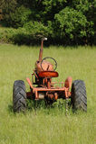Old Tractor in a Field Royalty Free Stock Image