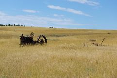 Old tractor in a field. Old abandoned tractor in field in Montana Stock Photography