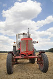 Old tractor in field Stock Photography