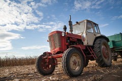 Old tractor in field Stock Photo