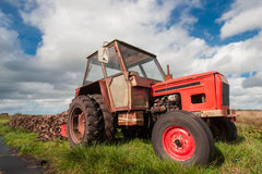 Old tractor in a field Stock Images