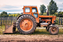 Old tractor on the ground Royalty Free Stock Images