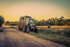 Old tractor with hay bales Stock Photo