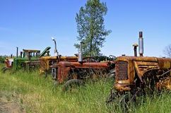 Old tractor lined up in junkyard Royalty Free Stock Photo