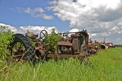 Old tractor in long grass Royalty Free Stock Images