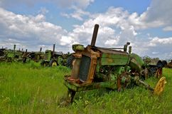 Old tractor in long grass Stock Photography
