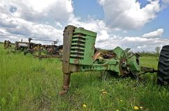 Old tractor in long grass Stock Photos