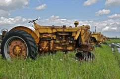 Old tractor in long grass Stock Photo