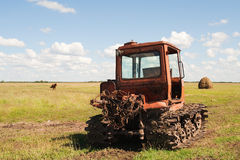 Old tractor on the meadow Royalty Free Stock Photography