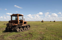 Old tractor on the meadow Royalty Free Stock Images