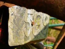 Old tractor Number plate. Vintage Tractor rusting away in field Royalty Free Stock Image