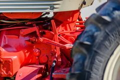 Old tractor is painted in red color stock photography