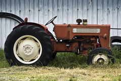 Old Tractor, Parked by the Barn Stock Photo