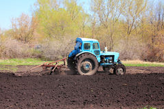 Old tractor with plough Royalty Free Stock Images