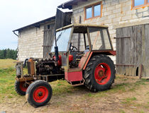Old tractor and a plow Stock Photos