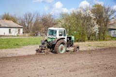 Tractor plows a plot of land Royalty Free Stock Photo