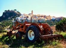 Old tractor and Polop de la Marina village Stock Photo