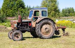 Old tractor at the russian village Royalty Free Stock Photos