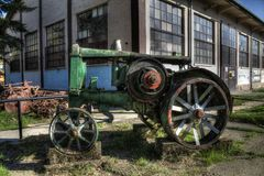 Old tractor. Old rusty tractor in front of the Faculty of Agriculture Royalty Free Stock Image